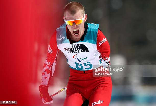 Mark Arendz of Canada celebrates after crossing the finish line of the Mens 75 km Standing Biathlon competition at Alpensia Biathlon Centre on Day 1...