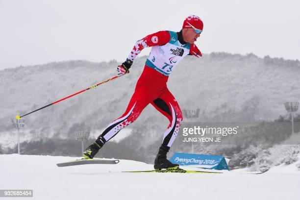 TOPSHOT Mark Arendz of Canada competes in the men's 15km standing biathlon event at the Alpensia Biathlon Centre during the Pyeongchang 2018 Winter...