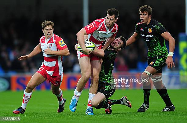 Mark Atkinson of Gloucester is tackled by Ceri Sweeney of Exeter Chiefs during the LV= Cup match between Exeter Chiefs and Gloucester at Sandy Park...