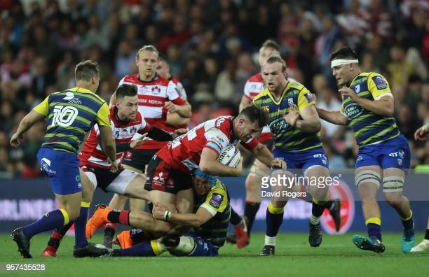 Mark Atkinson of Gloucester Rugby tries to break through the Cardiff Blues defence during the European Rugby Challenge Cup Final match between...