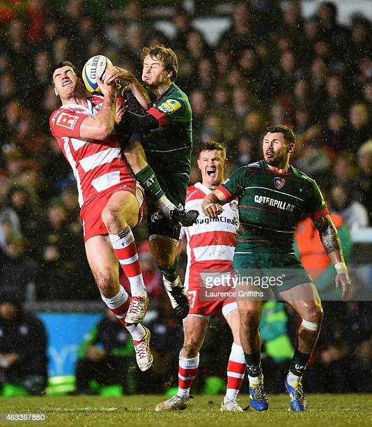 Mark Atkinson of Gloucester Rugy jumps for the ball with Matthew Tait of Leicester during the Aviva Premiership match between Leicester Tigers and...