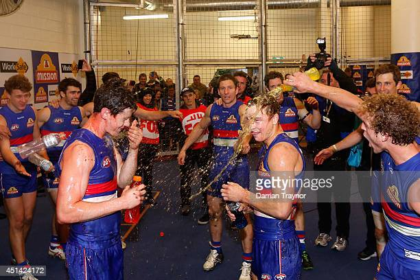Mark Austin and Mitch Honeychurch of the Bulldogs are showered in Gatorade after the round 15 AFL match between the Western Bulldogs and the...