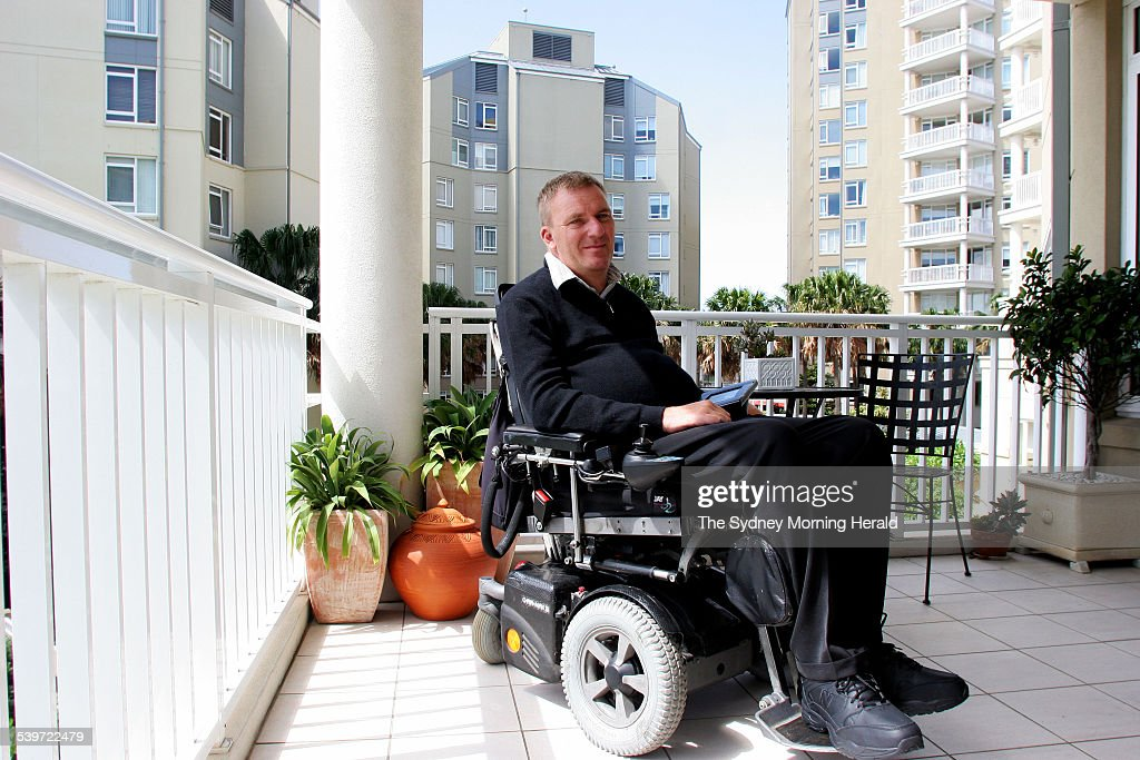 Mark Bagshaw who suffers a disability and is wheelchair bound operates a console : News Photo
