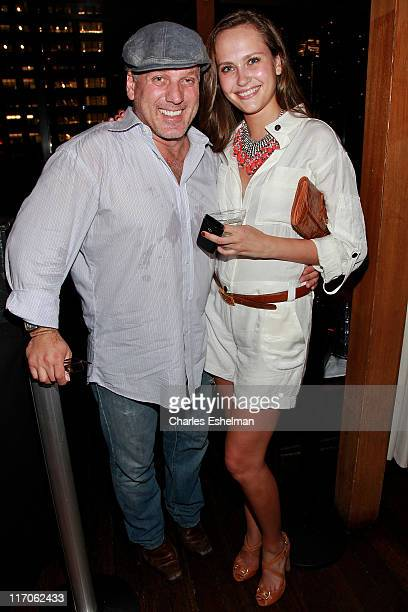 Mark Baker owner Lotus lounge and model Maryam Abdullina attend the Gotham And Hamptons Magazines party to kick off the summer at Hudson Terrace on...