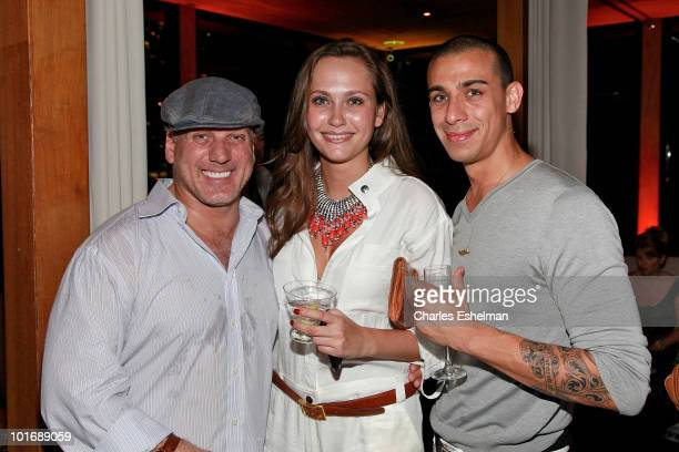 Mark Baker owner Lotus lounge model Maryam Abdullina and Alexander Esgueira attend the Gotham And Hamptons Magazines party to kick off the summer at...