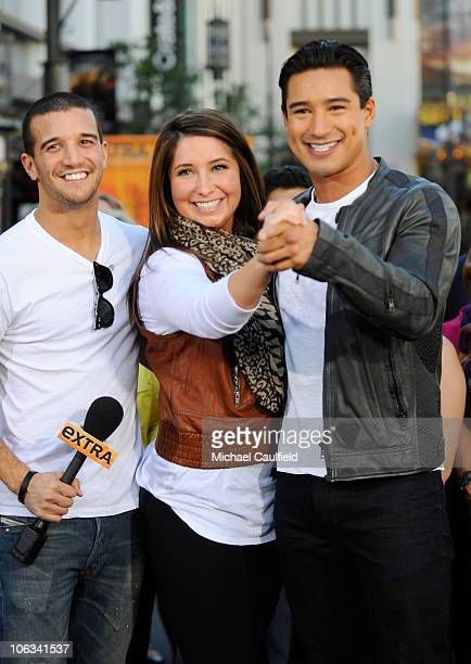 Mark Balas Bristol Palin and Mario Lopez pose on the set of Extra at the Grove on October 28 2010 in Los Angeles California