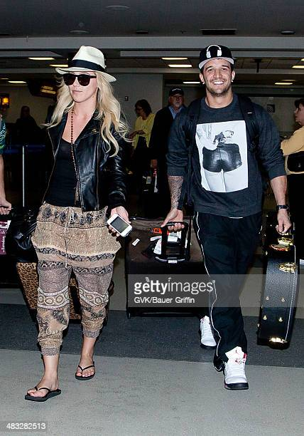 Mark Ballas and Britney Jean Carlson are seen at Los Angeles International Airport on February 23 2013 in Los Angeles California