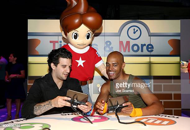 Mark Ballas of ABC's Dancing with the Stars and 'Dance It Out' founder Billy Blanks Jr check out YoKai Watch 2 for Ninendo 3DS at the YOKAI WATCH 2...