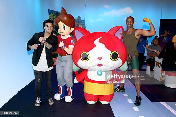 Mark Ballas of ABC's Dancing with the Stars and 'Dance It Out' founder Billy Blanks Jr interact with costume character Jibanyan at the YOKAI WATCH 2...