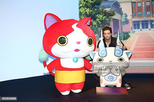 Mark Ballas of ABC's Dancing with the Stars interacts with costume character Jibanyan at the YOKAI WATCH 2 preview event at Siren Studios on...