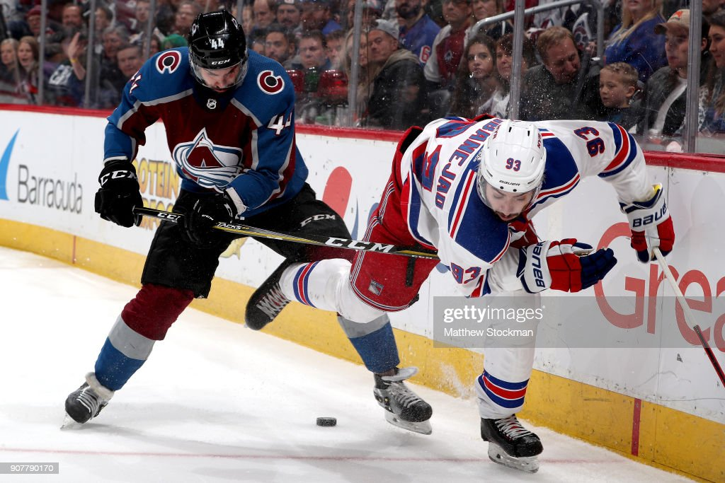 Mark Barberio #44 of the Colorado Avalanche fights for the puck on the boards against Mika Zibanejad #93 of the New York Rangers at the Pepsi Center on January 20, 2018 in Denver, Colorado.