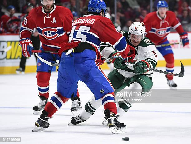 Mark Barberio of the Montreal Canadiens tries to slow down Zach Parise of the Minnesota Wild in the NHL game at the Bell Centre on March 12 2016 in...