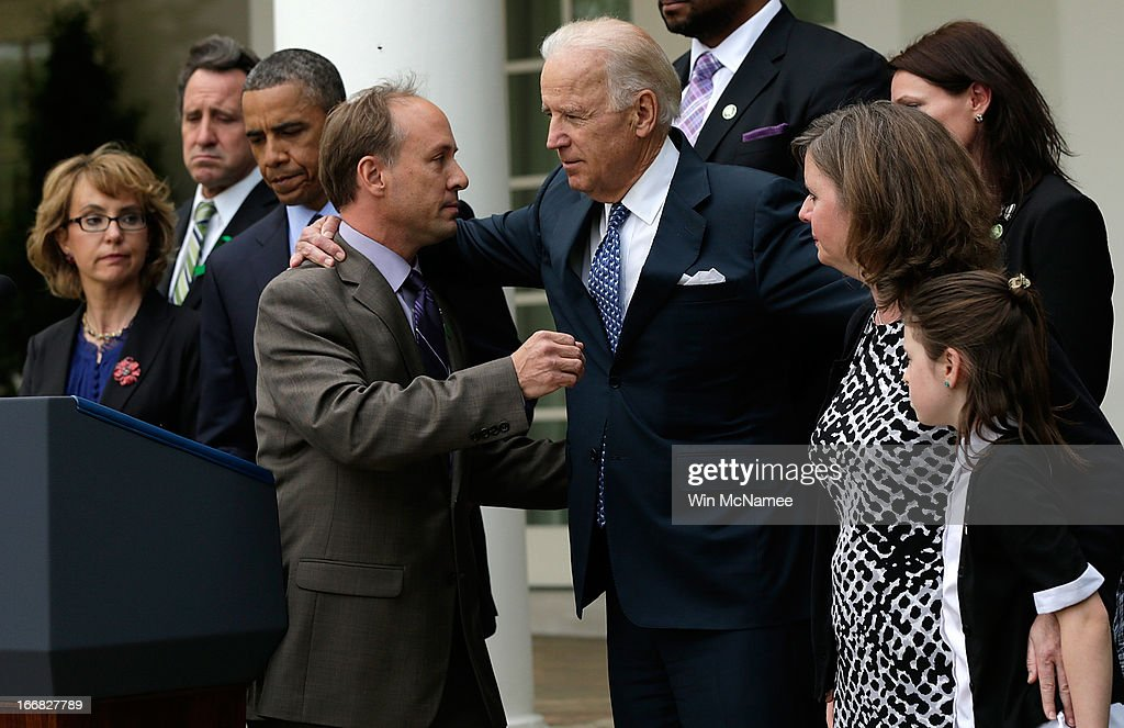 Mark Barden, the father of a victim at Sandy Hook Elementary School, is embraced by Vice President Joe Biden while joining U.S. President Barack Obama in making a statement on gun violence in the Rose Garden of the White House on April 17, 2013 in Washington, DC. Earlier today the Senate defeated a bi-partisan measure to expand background checks for gun sales. Also pictured (L) is former Rep. Gabby Giffords.