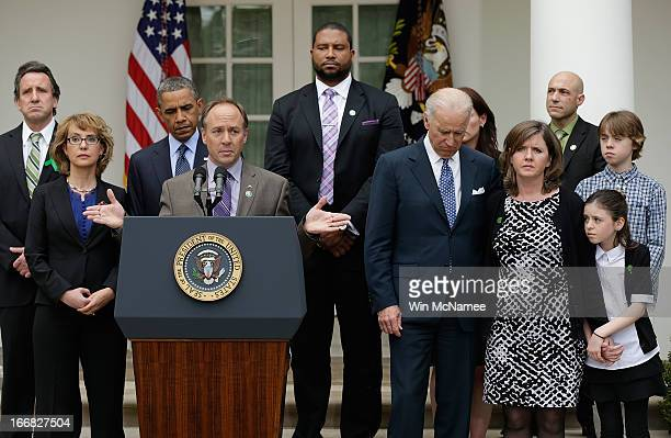 Mark Barden the father of a victim at Sandy Hook Elementary School joins US President Barack Obama and Vice President Joe Biden in making a statement...