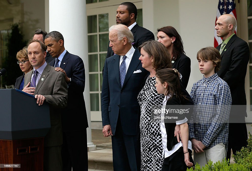 Mark Barden, the father of a victim at Sandy Hook Elementary School, joins U.S. President Barack Obama and Vice President Joe Biden in making a statement on gun violence in the Rose Garden of the White House on April 17, 2013 in Washington, DC. Earlier today the Senate defeated a bi-partisan measure to expand background checks for gun sales. Also pictured (L) is former Rep. Gabby Giffords.
