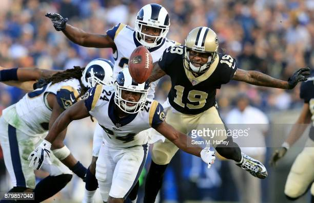 Mark Barron Blake Countess and Lamarcus Joyner of the Los Angeles Rams dive for a loose ball intended for Ted Ginn of the New Orleans Saints during...
