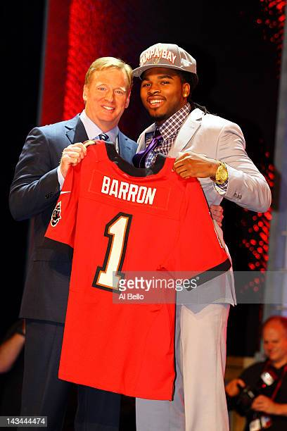 Mark Barron of Alabama holds up a jersey as he stands on stage with NFL Commissioner Roger Goodell after he was selected overall by the Tampa Bay...