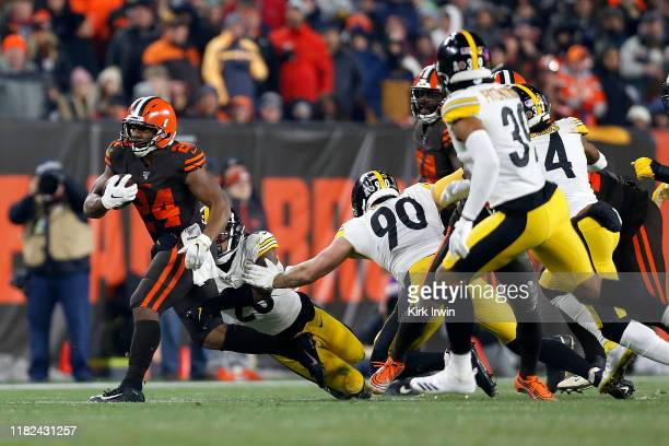 Mark Barron of the Pittsburgh Steelers attempts to tackle Nick Chubb of the Cleveland Browns during the third quarter at FirstEnergy Stadium on...