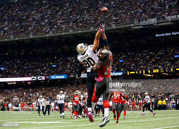 Mark Barron of the Tampa Bay Buccaneers defends a pass intended for Jimmy Graham of the New Orleans Saints during the first quarter of a game at the...