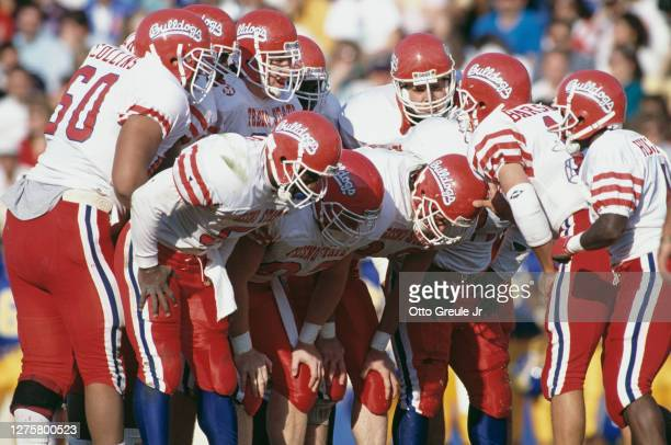 Mark Barsotti, Quarterback for the Fresno State Bulldogs instructs his offensive line in the huddle during the NCAA Western Athletic Conference...