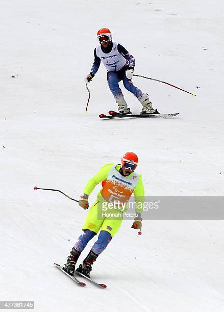 Mark Bathum of the United States with his guide Cade Yamamoto in the Men's Super G Visually Impaired during day two of Sochi 2014 Paralympic Winter...