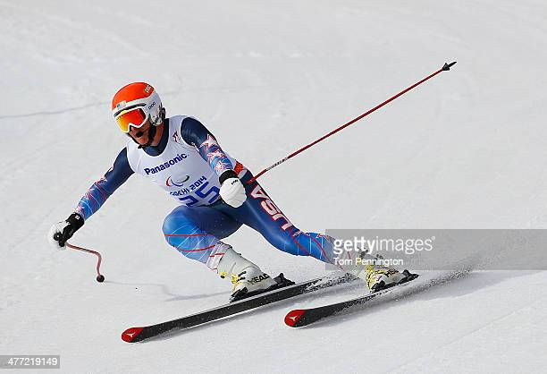 Mark Bathum of United States competes in the Men's Downhill - Visually Impaired during day one of Sochi 2014 Paralympic Winter Games at Rosa Khutor...