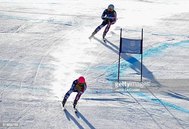 Mark Bathum of USA and guide Storey Slater compete in the Men's Visually Impaired Super-G during Day 8 of the 2010 Vancouver Winter Paralympics at...