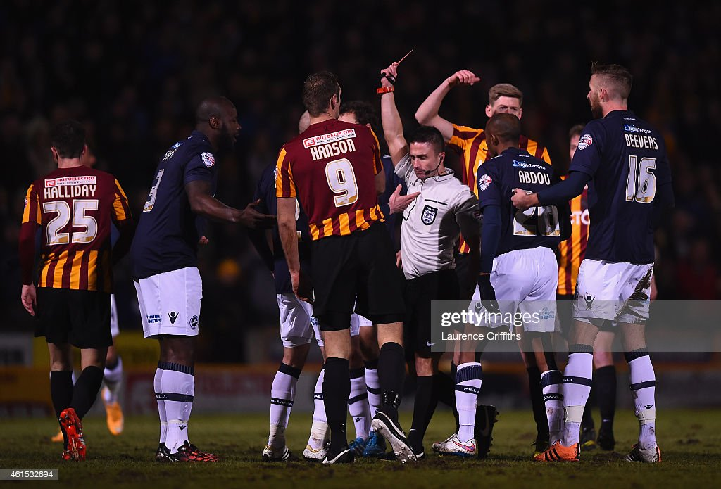Mark Beevers of Millwall is sent off by Referee James Adcock during the FA Cup Third Round Replay between Bradford City and Millwall at Coral Windows Stadium, Valley Parade on January 14, 2015 in Bradford, England.