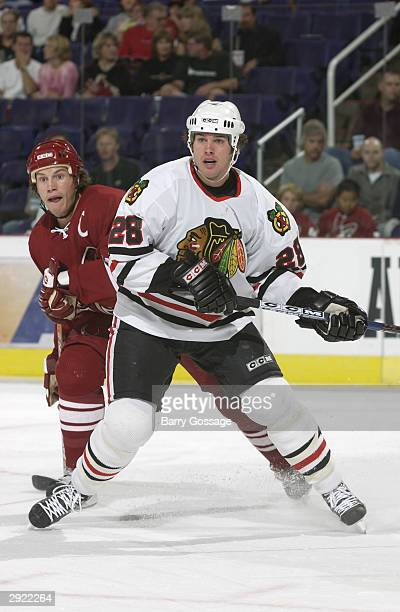Mark Bell of the Chicago Blackhawks vies for position with Shane Doan of the Phoenix Coyotes on October 28 2003 at America West Arena in Phoenix...