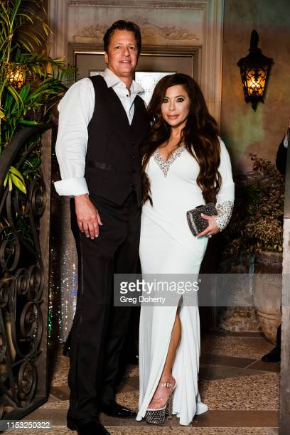 Mark Bellas and Brooke Lewis wearing a 'Jovani' designed dress at Brooke Mark's Marriage Soiree The Magic Of Hollywood Houdini Estate on June 01 2019...
