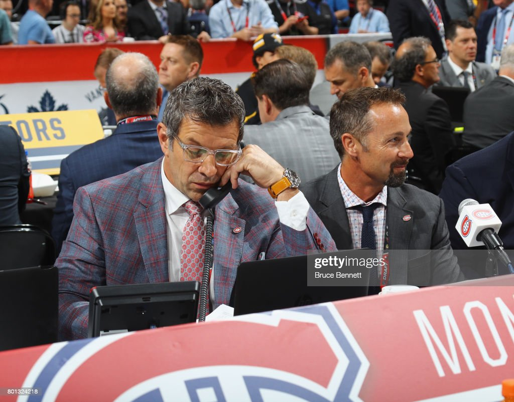 Mark Bergevin and Trevor Timmins of the Montreal Canadiens work the 2017 in Chicago, Illinois.