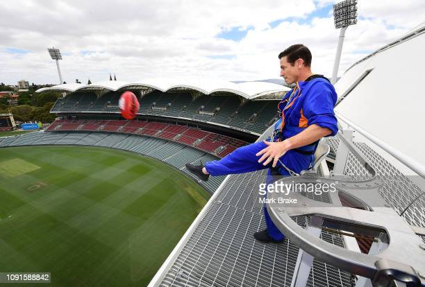 Mark Bickley kicks a football off the top of the Riverbank stand aiming at a target on the oval to decide the draw during the Official Draw ahead of...