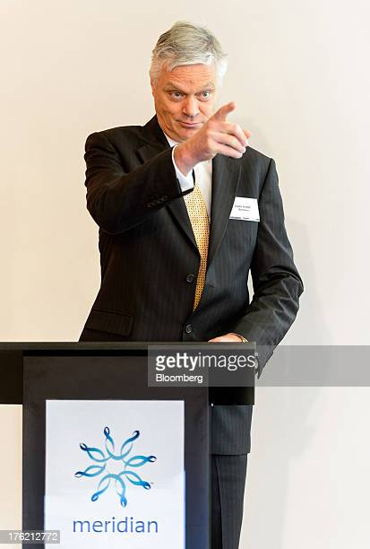 Mark Binns chief executive officer of Meridian Energy Ltd gestures to a member of the media during a news conference in Wellington New Zealand on...