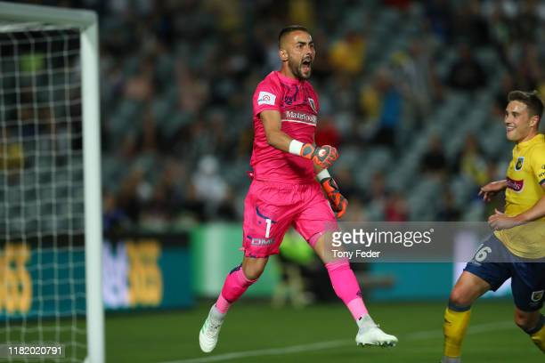 Mark Birighitti of the Central Coast Mariners saves a penalty during the round two A-League match between the Central Coast Mariners and the...
