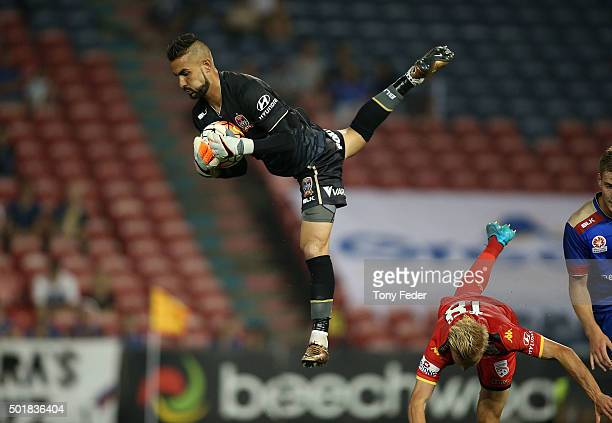 Mark Birighitti of the Jets makes a spectacular save during the round 11 ALeague match between the Newcastle Jets and Adelaide United at Hunter...