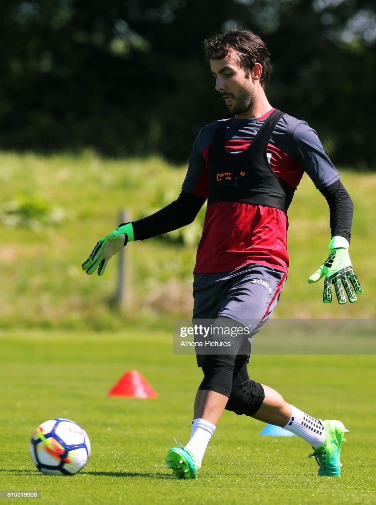 Mark Birighitti passes the ball during the Swansea City Training at The Fairwood Training Ground on July 5, 2017 in Swansea, Wales.