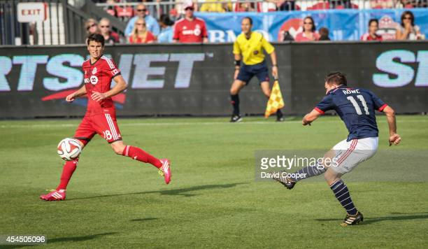 Mark Bloom of TFC watches as Kelyn Rowe scores the 2nd goal for the Revolution during the game between Toronto FC and New England Revolution at BMO...