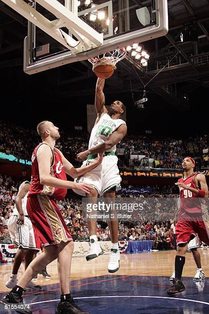 Mark Blount of the Boston Celtics dunks against Zyrunas Illgauskas Drew Gooden of the Cleveland Cavaliers during preseason on October 23 2004 at the...