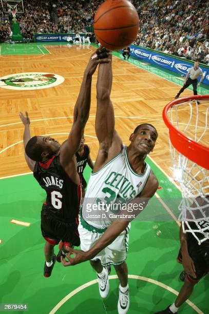 Mark Blount of the Boston Celtics shoots against Eddie Jones of the Miami Heat October 29 2003 at the Fleet Center in Boston Massachusetts NOTE TO...
