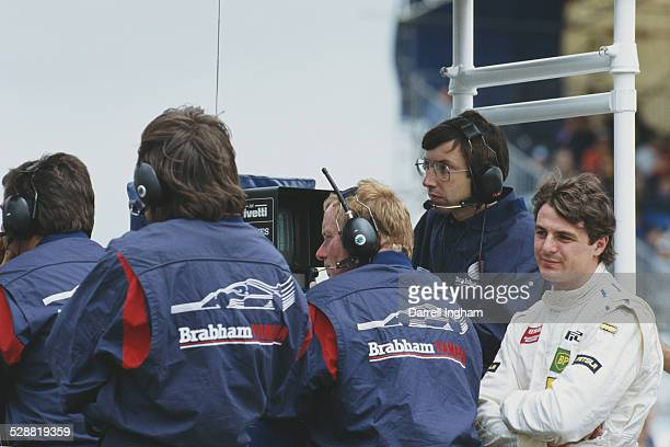 Mark Blundell of Great Britain, driver of the Motor Racing Developments Ltd Brabham BT60Y Yamaha V12 checks the lap times during practice for the...