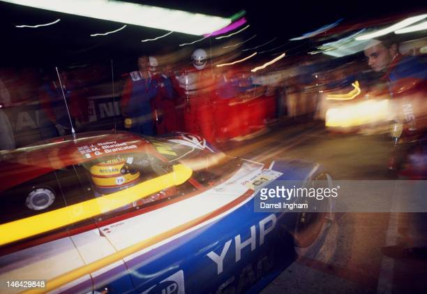 Mark Blundell of Great Britain drives the Nissan Motorsports International Nissan R90CK into the pits during the FIA World Sportscar Championship 24...