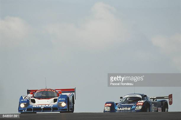 Mark Blundell of Great Britain drives the Nissan Motorsports International Nissan R90CK ahead of the Courage Competition Cougar C24S driven by Pascal...