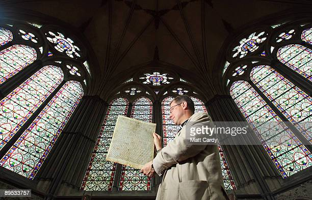Mark Bonney Canon Treasurer at Salisbury Cathedral looks at a facsimile copy of the 1215 document the Magna Carta in the Chapter House at Salisbury...
