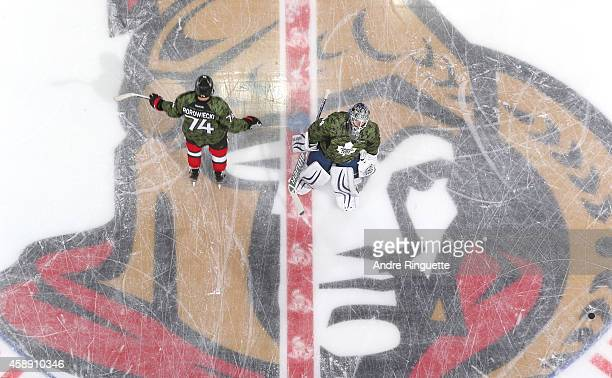 Mark Borowiecki of the Ottawa Senators and Peter Holland of the Toronto Maple Leafs wear special camouflage jerseys in honor of Remembrance Day as...