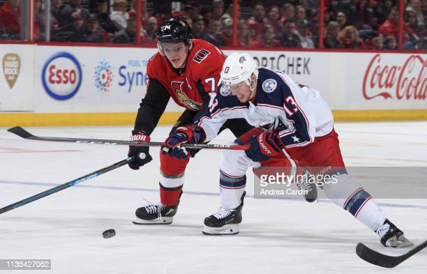 Mark Borowiecki of the Ottawa Senators battles for the puck with Cam Atkinson of the Columbus Blue Jackets at Canadian Tire Centre on April 6 2019 in...