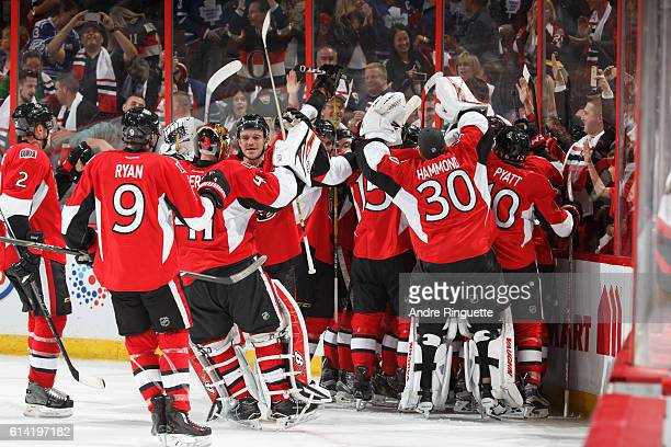 Mark Borowiecki of the Ottawa Senators celebrates an overtime win over the Toronto Maple Leafs with teammates at Canadian Tire Centre during the...