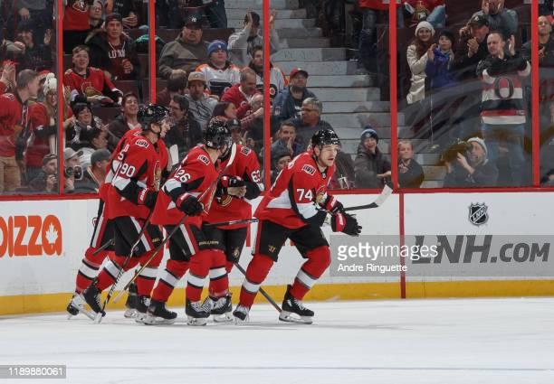 Mark Borowiecki of the Ottawa Senators celebrates his second period goal against the Philadelphia Flyers with teammates Vladislav Namestnikov and...