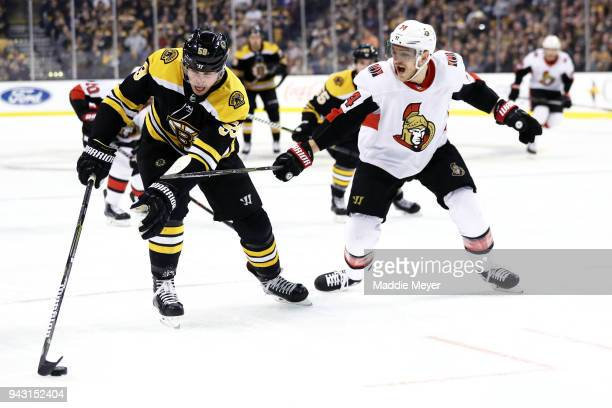 Mark Borowiecki of the Ottawa Senators defends Tim Schaller of the Boston Bruins during the first period at TD Garden on April 7 2018 in Boston...