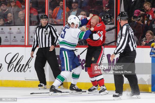 Mark Borowiecki of the Ottawa Senators fights Derek Dorsett of the Vancouver Canucks in the second period at Canadian Tire Centre on October 17 2017...