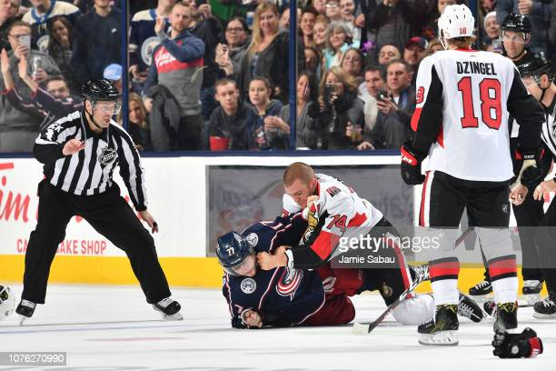 Mark Borowiecki of the Ottawa Senators fights Josh Anderson of the Columbus Blue Jackets during the second period of a game on December 31 2018 at...